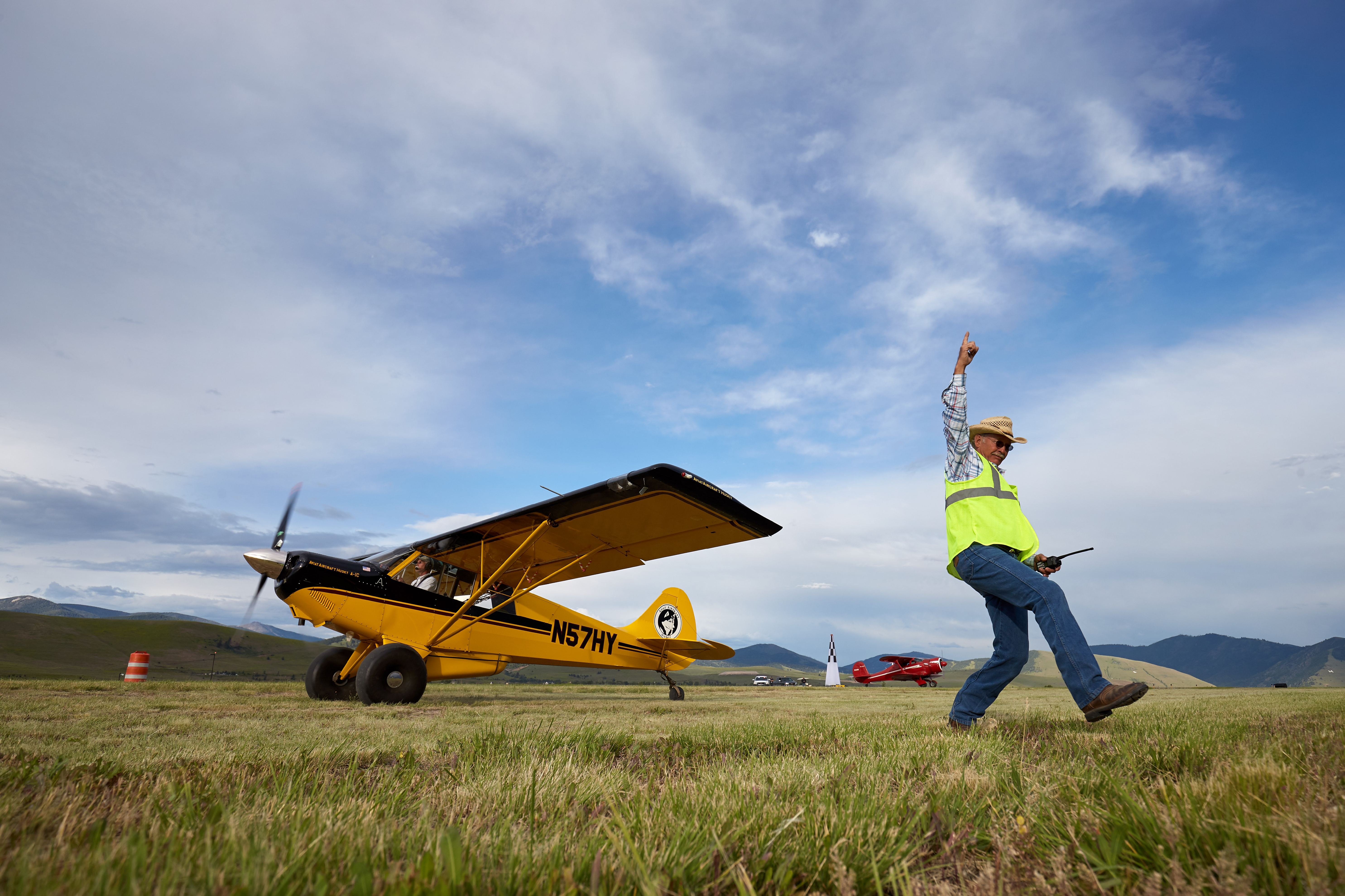 Texan Jimmie Gist, acting Aircraft Wrangler, orchestrates a STOL (Short Take Off and Landing) demonstration at the 2018 AOPA Fly In at Missoula.Missoula Airport (MSO)Missoula, MT