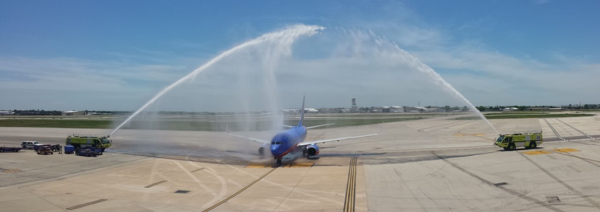 Debby Rihn-Harvey taxis a Southwest Airlines Boeing 737 through her celebratory and honorary water cannon/arch from Runway 4 to Gate 50 at Houston's William P. Hobby Airport. Photo by Yasmina Platt.