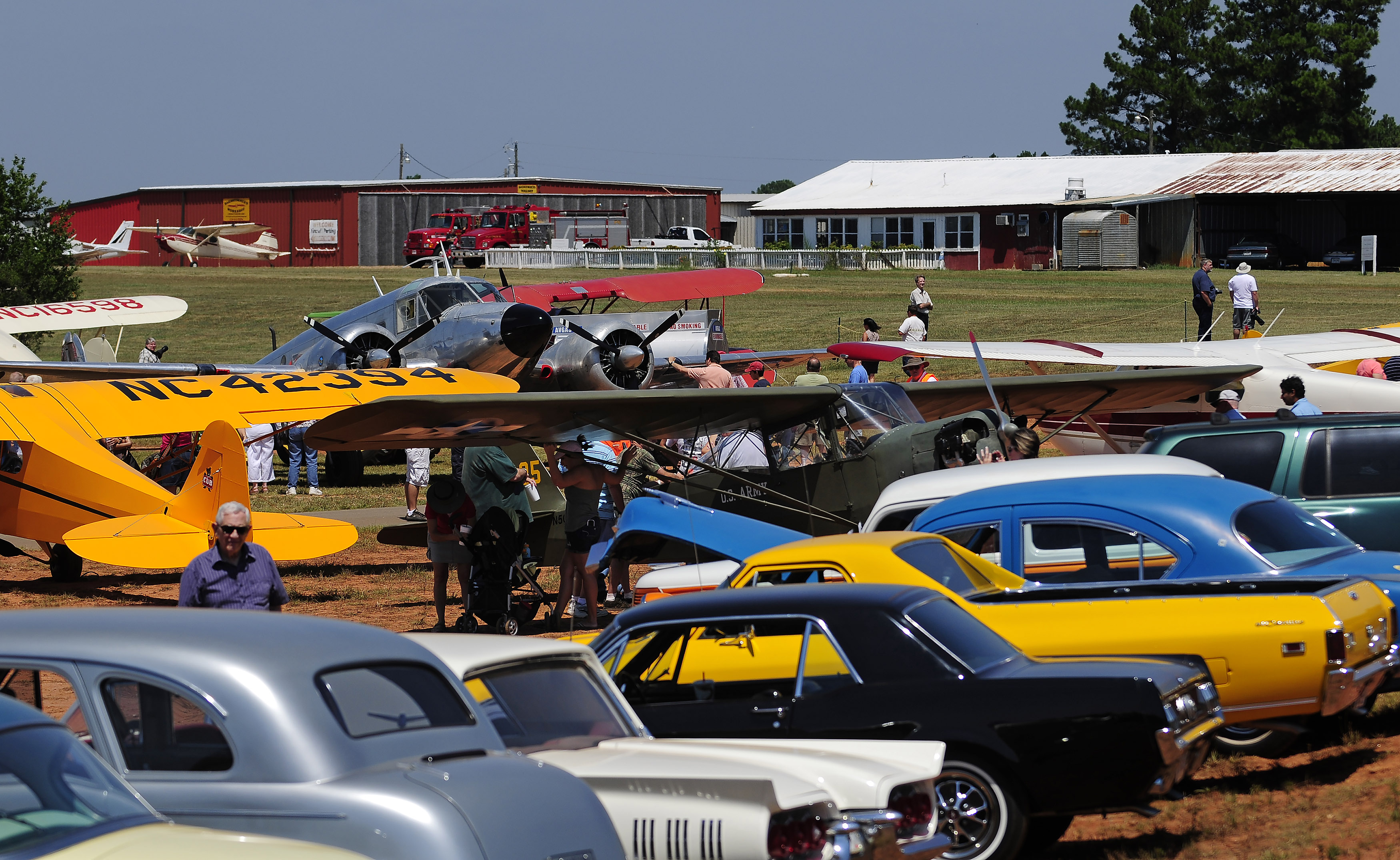 Classic and antique automobiles and airplanes line the ramp at during the 2011 Vintage Day celebration in Williamson, Georgia. Photo by David Tulis.