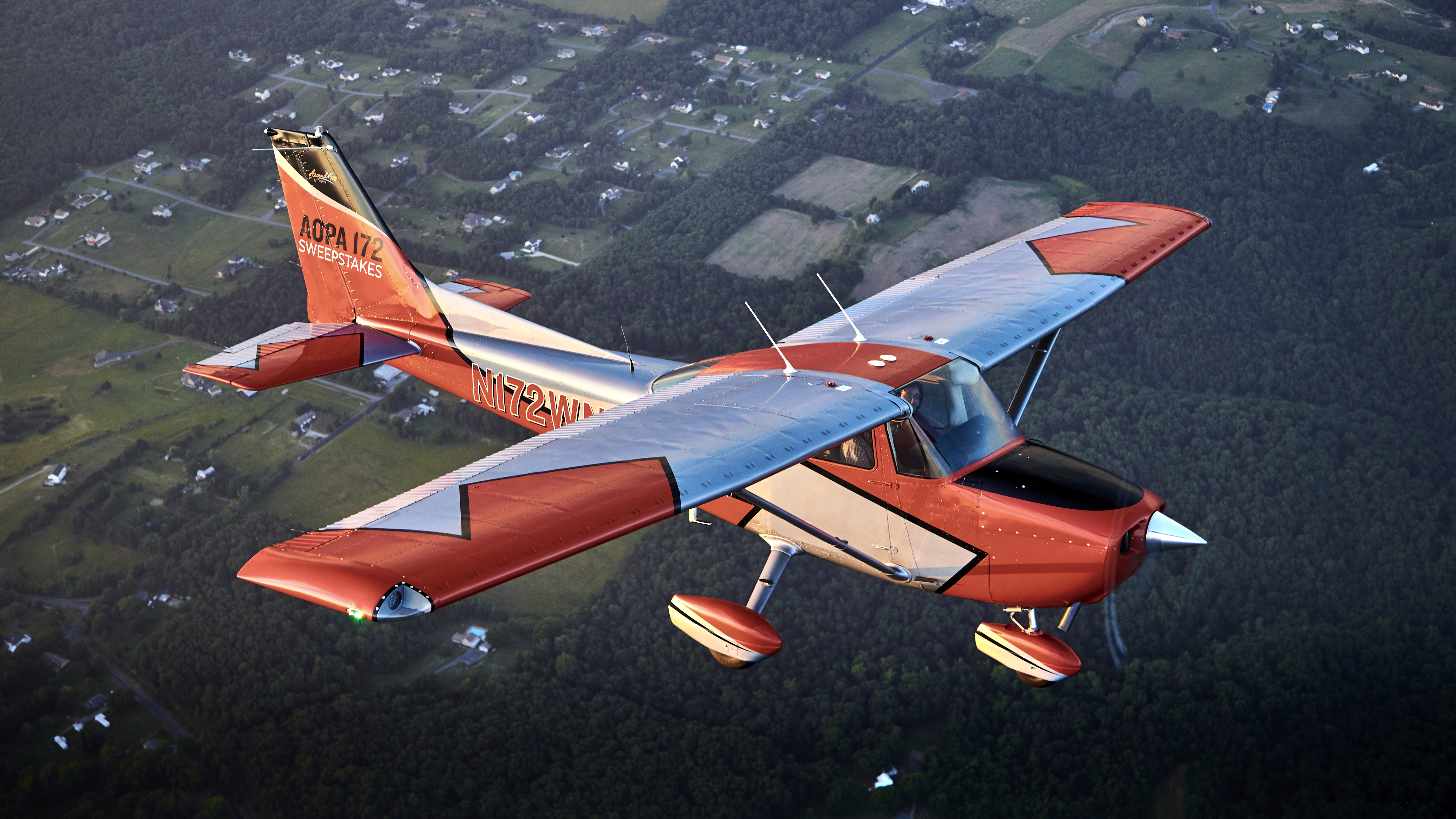 Aerial photography of the AOPA Sweepstakes Cessna 172 Ascend with the new paint job.