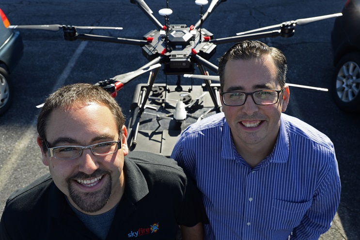 Matt Sloane (L) and Ben Kroll of SkyFire Consulting help teach drone concepts to fire department and rescue personnel March 20 in Frederick, Maryland. Photo by David Tulis.