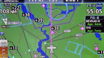 A panel-mounted navigation unit displays a line of aircraft returning to Daytona Beach's Embry-Riddle Aeronautical University after Hurricane Irma Sept. 13. Photo by David Tulis.