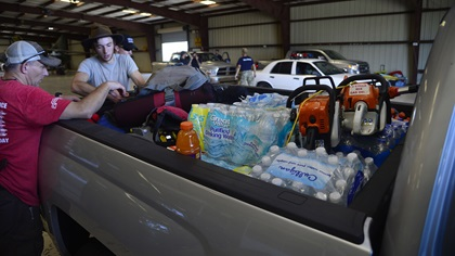 Members of Task Force 75, veterans of the U.S. Army's 75th Ranger Regiment, load up chain saws, water, and staple items inside a Sun 'N Fun International Expo hangar at Lakeland Linder Regional Airport for delivery to Hurricane Irma victims Sept. 13. Photo by David Tulis.