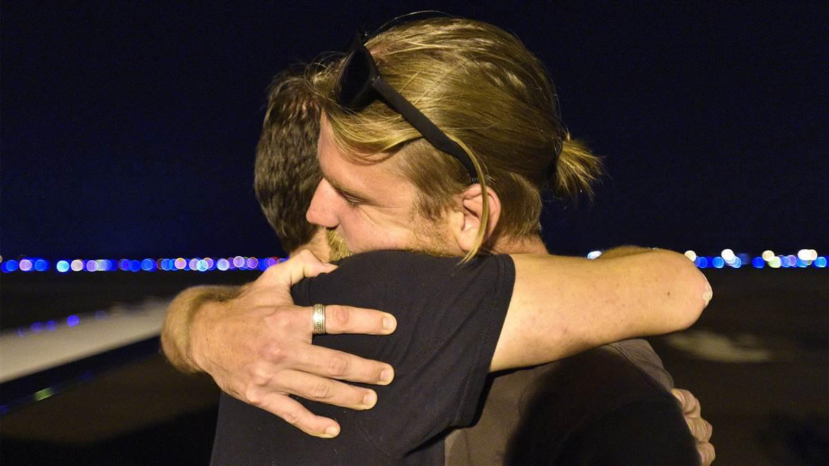 Hurricane Irma evacuee Chris Norton hugs his brother after arriving via general aviation aircraft at Lakeland Linder Regional Airport, a major staging area for relief missions, Sept. 14. Norton and his two dogs survived the powerful storm's blow to St. John, a former island paradise that was destroyed by fierce winds, tides, and rain. Photo by David Tulis.