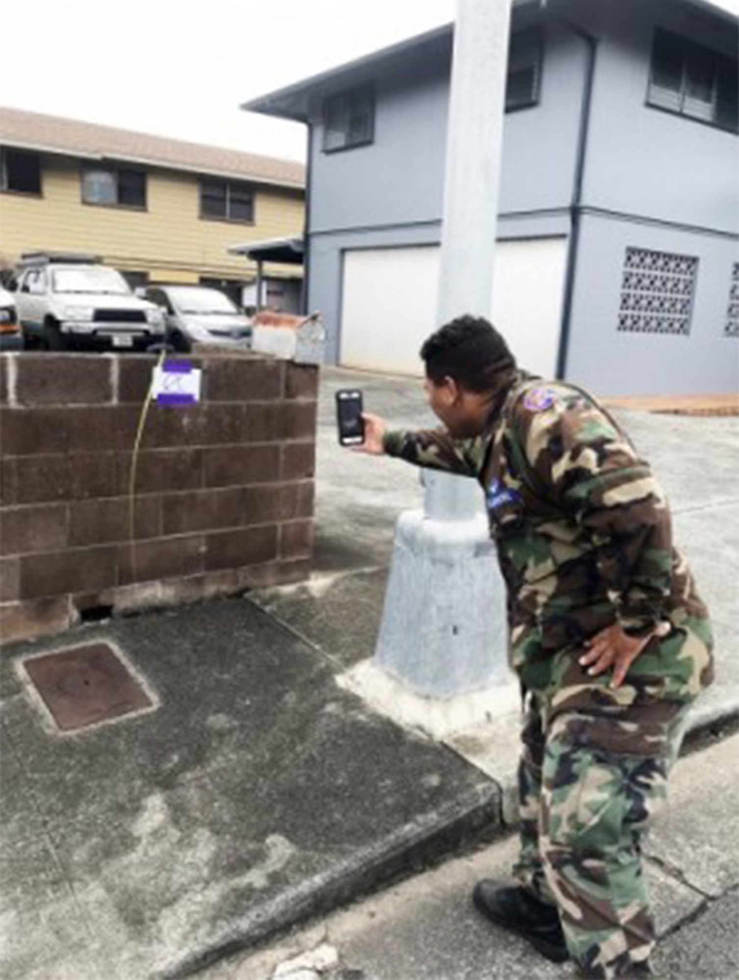 Civil Air Patrol members in Hawaii were directed to collect data with their cell phones to help provide more accurate Hurricane Lane damage reports to the Federal Emergency Management Agency, Aug. 28, 2018. Second Lt. Kamalama Kaikuana, the Hawaii Wing's assistant director of communications, tries out the FEMA app he downloaded to his phone on the island of Oahu. Photo courtesy of the Civil Air Patrol.