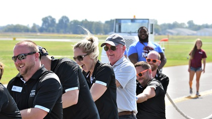 An AOPA employee team--including AOPA President Mark Baker, in tan shirt--competes in Special Olympics Illinois' Southern Illinois Plane Pull. Photo by Mike Collins.