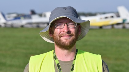 Craig Blumer of Springfield, Illinois--a pilot, flight instructor, and air traffic controller--rode his bicycle 280 miles to AOPA's 2018 Carbondale, Fly-In where he volunteered marshalling aircraft. Photo by Mike Collins.