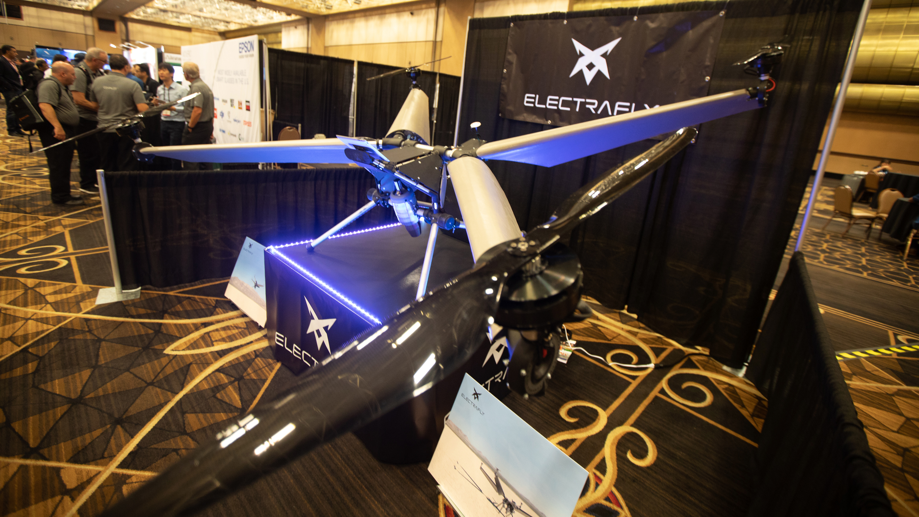 The Electrafly prototype was on display at Interdrone in Las Vegas, a first public appearance for a unique aircraft that has yet to fly without a tether. The unique design includes four airfoils, four electric motors, a small turbojet engine mounted below the saddle, and a hybrid electric power system. Photo by Jim Moore.