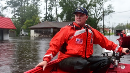 U.S. Coast Guard Petty Officer 2nd Class Gaaron Blanchard, a shallow-water response boat team member, steers a 16-foot aluminum rescue boat through floodwaters caused by Hurricane Florence in Newport, North Carolina, Sept. 15. The Coast Guard deployed 35 shallow-water response teams to assist in the rescue effort as rising waters trapped hundreds of people across the state. U.S. Coast Guard photo by Petty Officer 1st Class Seth Johnson.