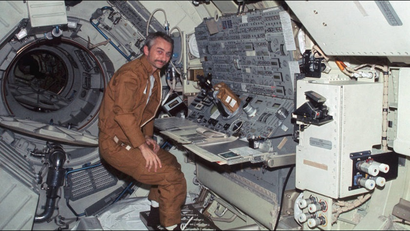 Scientist-astronaut Owen K. Garriott aboard the Skylab 3 mission is stationed at the Apollo Telescope Mount console during Earth orbit. From this console the astronauts actively controlled the solar physics telescope. Photo courtesy of NASA.