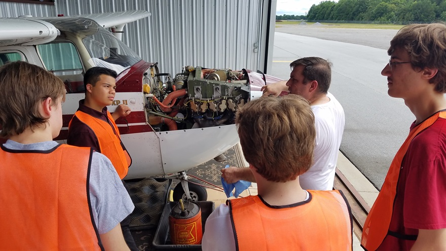 In addition to learning about piloting aircraft, students learn about the mechanics and maintenance of aircraft. Photo by Les Singleton.