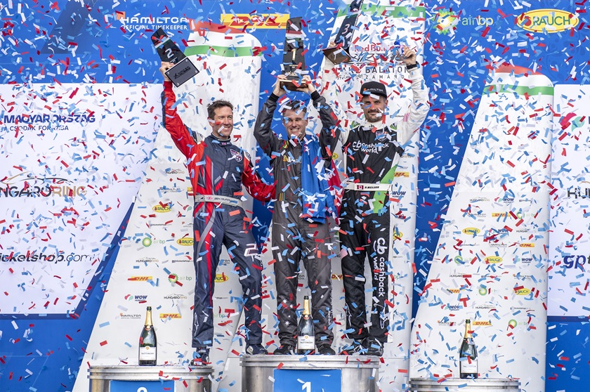 Matt Hall of Australia, center, celebrates with Ben Murphy of Great Britain and Pete McLeod of Canada, right, during the award ceremony following the Red Bull Air Race World Championship at Lake Balaton, Hungary on July 14. Photo courtesy of Joerg Mitter, Red Bull Content Pool.