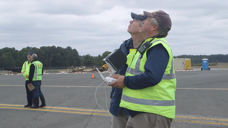 NTSB investigator and drone pilot Mike Bauer flies at the scene of an October 2 crash of a vintage warbird at Bradley International Airport in Connecticut. Photo courtesy of the NTSB via YouTube.