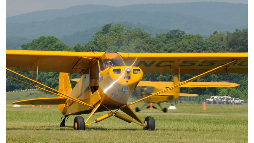 A Cub taxis for takeoff at the 2012 Sentimental Journey fly-in. Photo by Mike Collins.