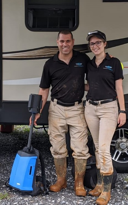 Nir and Amanda Pe'er clearly don't mind getting their hands dirty in their efforts to push their droning and scanning to the limits. Here, they are seen with a backpack lidar unit that also records 360-degree video. Photo courtesy of Inspired Intelligence.