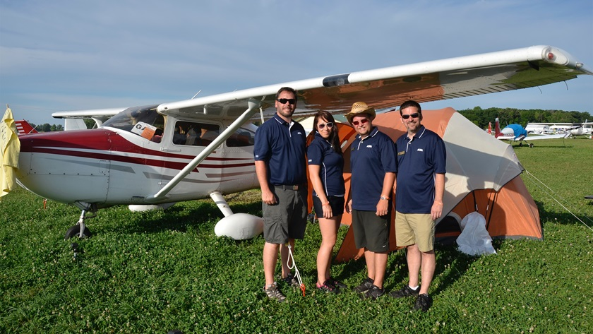 The author and fellow AOPA colleagues pitched several tents underneath a pair of Cessna 182s at EAA's AirVenture. The trip to and from Oshkosh contained many great lessons in VFR flying. Pictured left to right, AOPA Outreach and Events leaders Dan Justman, Elizabeth O'Connell, Sean White, and Chris Eads. Photo by Chris Eads.