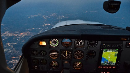 As dusk turned to dark, it was time for weary pilots to call it a night. When flying for enjoyment or personal travel, there is no reason to push through fatigue. Two hours from Oshkosh, a descent into Toledo, Ohio, for the night was imminent. Photo by Chris Eads.