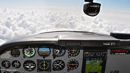 Pilots can encounter unexpected weather on long-range VFR trips. A thick cloud layer that extended well beyond the original forecast meant that this VFR-over-the-top flight segment would require either a significant diversion of many miles or an airborne IFR clearance, the latter only made possible by the proficient, current CFII on board.