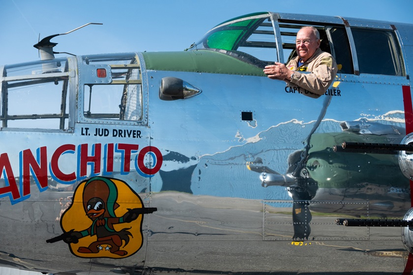 "Tom Womack does the B-25 hero pose while prepping for a flight in ""Panchito."" The second-in-command type rating course he won was in remembrance of his father, a bombardier/navigator in Mitchells during World War II. Photo by Sabrina Kipp, courtesy of the Delaware Aviation Museum Foundation."