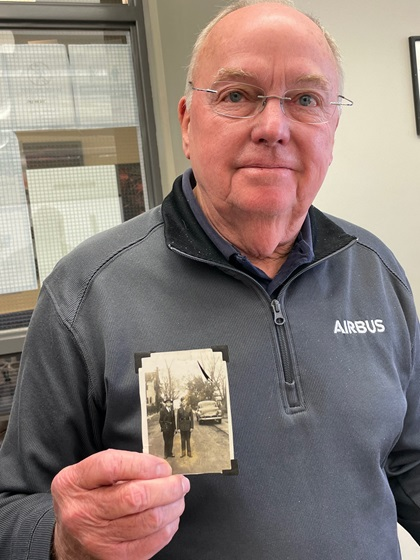 Tom Womack, winner of a B-25 second-in-command type rating course, holds a photo of his father and grandfather taken during World War II. Photo by Tom Haines.