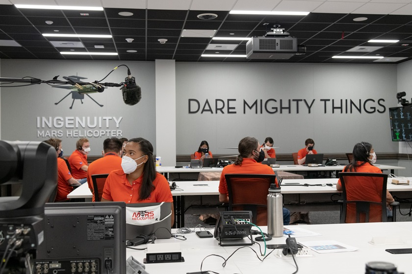 "Members of NASA's ""Ingenuity"" helicopter team in the Space Flight Operations Facility at NASA's Jet Propulsion Laboratory prepare to receive the data downlink showing whether the helicopter completed its first flight on April 19, 2021. Photo courtesy of NASA/JPL-Caltech."