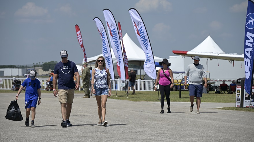 Sun 'n Fun Aerospace Expo attendees stroll past the static display area on April 14. Photo by Phelan M. Ebenhack.