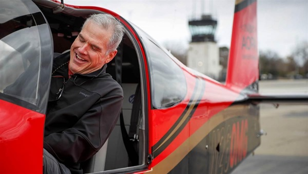 The surprise of winning the AOPA Sweepstakes Van's Aircraft RV-10 sets in as Aaron Benedetti sits in the left seat at California's Livermore Municipal Airport on January 24, just minutes after the big reveal. Photo by Chris Rose.