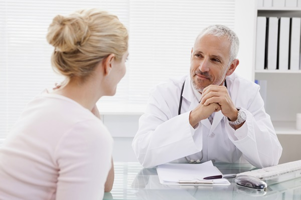A doctor consults with a patient during a medical visit. iStock photo.