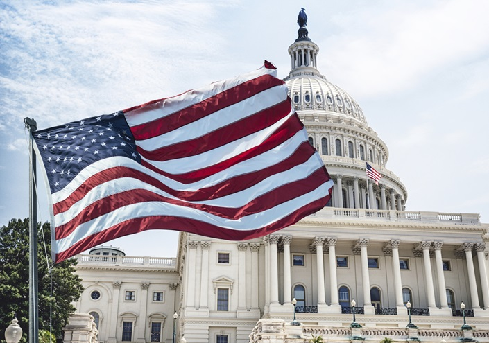 An American flag waves during a national holiday in Washington, D.C. iStock photo.