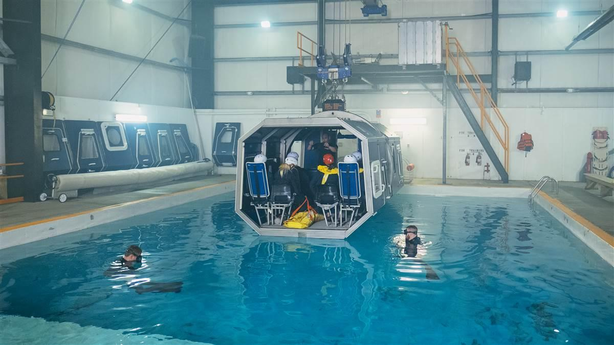 The Modular Egress Training (MET) simulator, being readied for a dunking. Students exit through side doors that jettison.