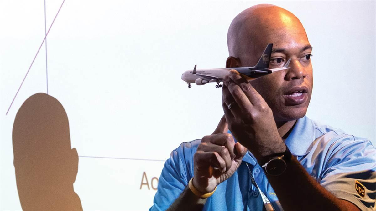Capt. Sean Horton uses a model Boeing 767 aircraft to complement his presentation about roll stability. Photography by Mike Collins.