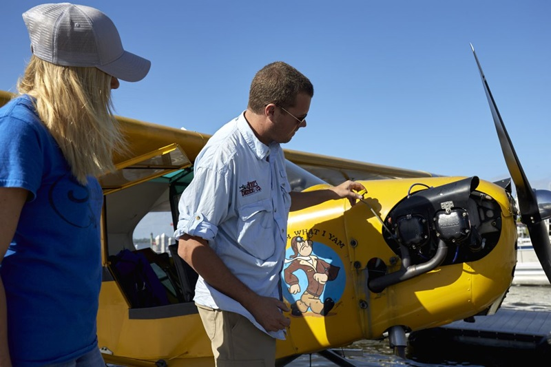 Photography of an instructor and student training with a Piper Cub on floats. Rob and Meghan Galloway.Tavares Seaplane Base (FA1)Tavares, FL USA