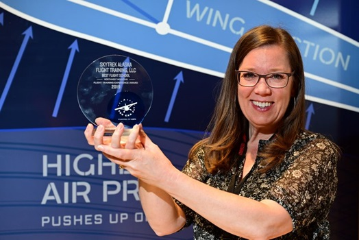 Jamie Patterson-Simes from SkyTrek Alaska Flight Training receives recognition as the best flight school in the Northwest Mountain region during the 2019 AOPA Flight Training Experience Awards in Denver, October 16, 2019. Photo by David Tulis.