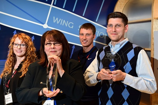 George and Debra Allen of AeroVenture, with other members of their team, are recognized as the best school int he U.S. during the 2019 AOPA Flight Training Experience Awards at the Wings Over the Rockies museum in Denver, October 16, 2019. Photo by David Tulis.