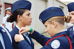 A Central Florida Aerospace Academy junior ROTC cadet bestows a new rank on another cadet.