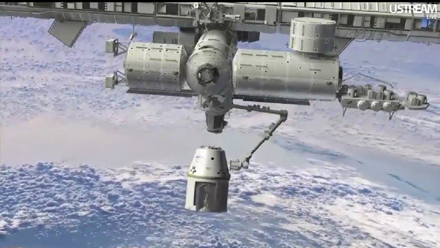 A NASA/SpaceX animation showing the Dragon spacecraft in the grip of the International Space Station's robotic arm. Photo courtesy of NASA.