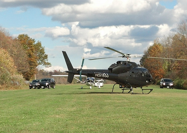 A black helicopter, FBI, and police vehicles set up for a television shoot at Warwick Municipal Airport in Warwick, N.Y. Oct. 24. Photo courtesy of Frank Galella III.