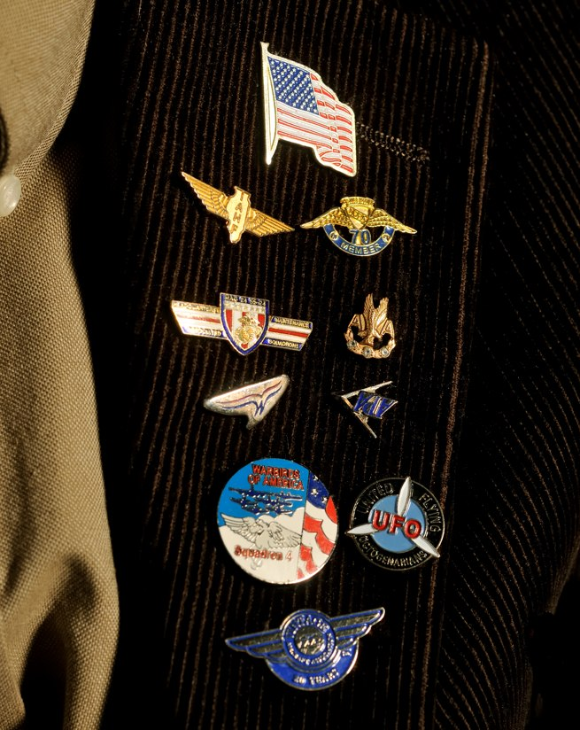 Hess proudly wears a collection of aviation lapel pins.
