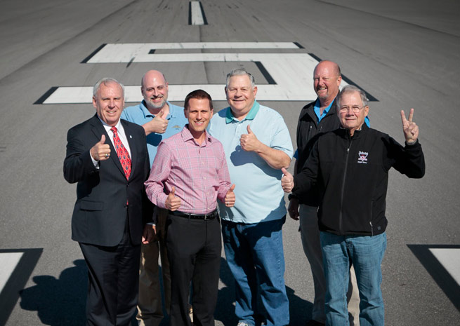 Kit McKeon, Venice City Council member; John Collins, AOPA manager of airport policy; Chris Rozansky, Venice Municipal Airport administrator; Nick Carlucci, VASI president emeritus; Brett Stephens, VASI president; and Paul Hollowell, VASI board of directors, on Runway 5/23 at Venice Municipal Airport.
