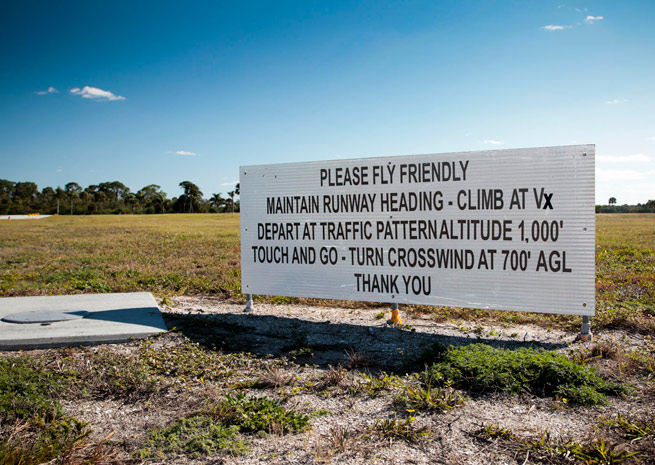 "Noise reduction signs were installed by the Venice Aviation Society Inc. (VASI) in 2009. The ""Always Fly Friendly"" signs verbally and graphically depict noise-reduction flight procedures at the departure ends of each of the airport's two 5,000-foot runways."