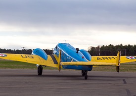 "The Blue and Gold ""Chow Hound,"" a vintage C-45H, has become a familiar sight at airports around New England."