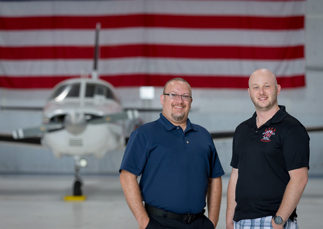 Todd Barker (left) and Anthony Thomas, both deaf pilots, met at Colorado Springs and now work together at Peak Aviation Center. Photo by Mike Fizer.