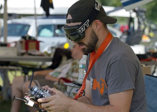 FPV pilot Josh Noone (aka Slowjet, Slow Jams) races at NAFPV2015 in Stephentown, New York Aug. 14. Photo by Jim Moore.