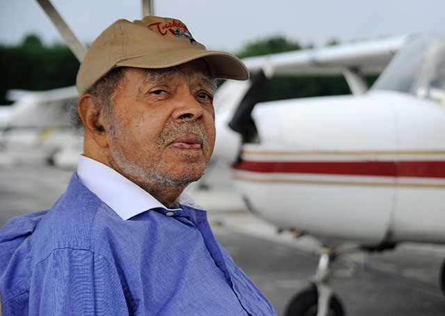 World War II Tuskegee Airman Lt. Floyd Collins, who trained in Mustang P-51 airplanes at South Dakota's Rapid City Army Air Base, visits the Montgomery County Airpark. Photo by David Tulis/AOPA.