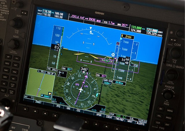 An avionics display shows an LPV procedure being flown.