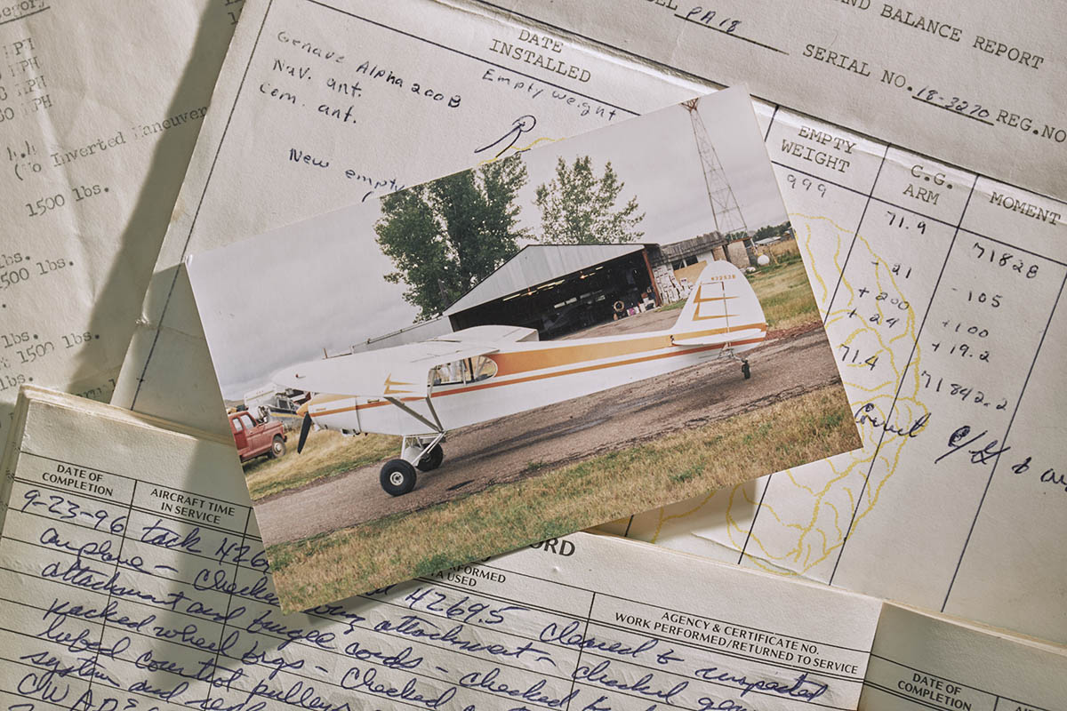 Photography of the 2018 AOPA Sweepstake Piper Super Cub restoration by Baker Air Service's Roger  and Darin Meggers. Shown is a photograph of the Cub before the accident, along with log books.Baker Air Services (BHK)Baker, MT USA