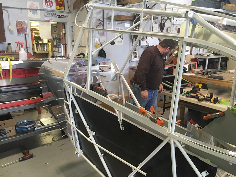 Baker Air Service's John Anderson works with Darin Meggers on the Super Cub's restoration. Photo courtesy of Baker Air Service.