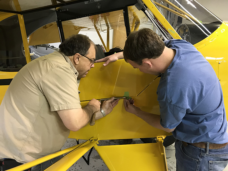 Installing the Super Cub's door.