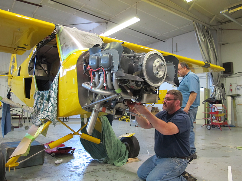 Baker Air Service's Jon Anderson works on the Super Cub's new Lycoming O-320 engine. Photo by Alyssa J. Cobb.