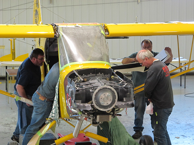 Just days before the Super Cub's planned test flight, it's all hands on deck at Baker Air Service. Photo by Alyssa J. Cobb.